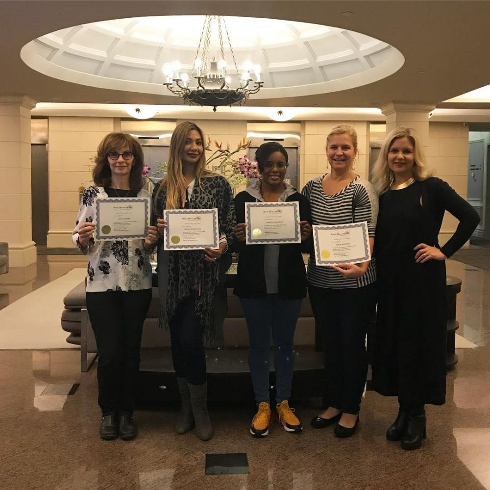 Group of women holding their certificates for Heal Your Life Training.