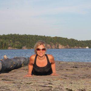 Heidi doing yoga along the lake.