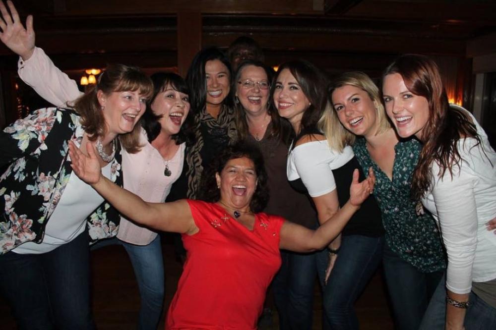 Women having a fun night during Heal Your Life Training.