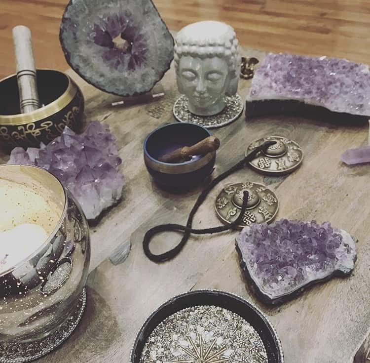 Table with amethyst crystals on them.
