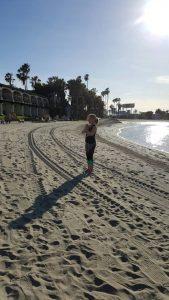 Heidi in a yoga pose on the beach.