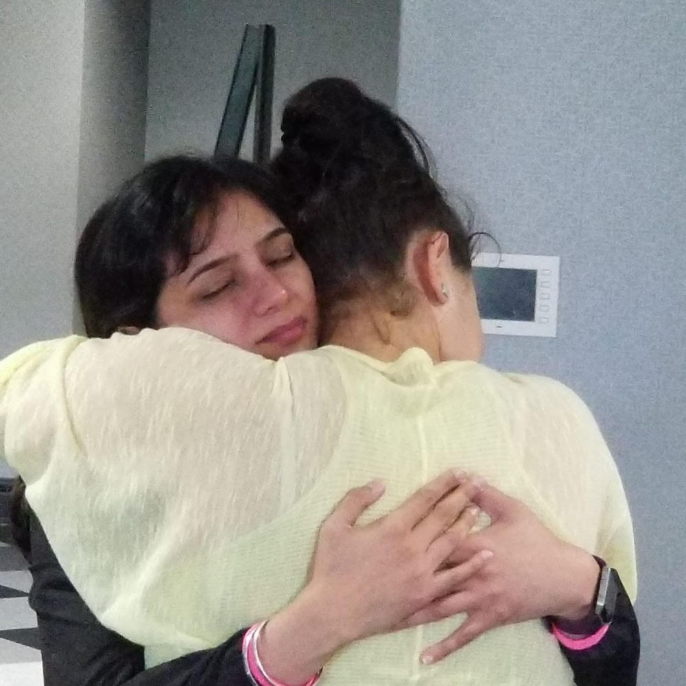 Two women hugging during the Heal Your Life Teacher Training.