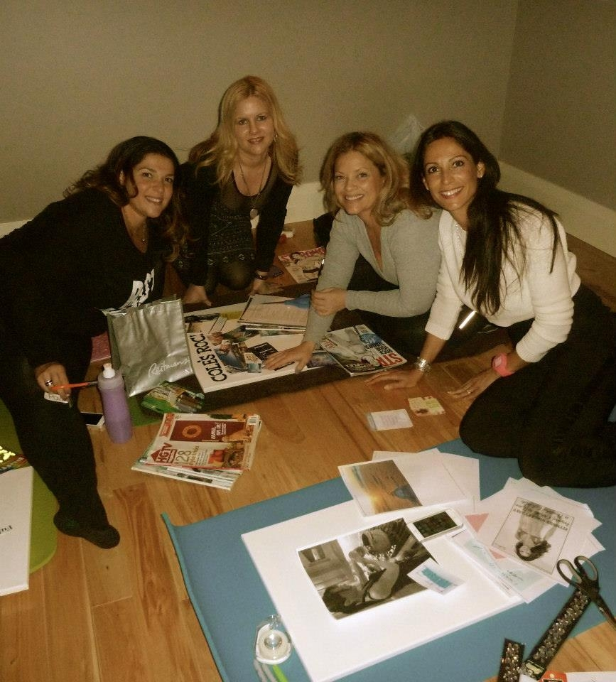 Women cutting pages out of magazines during a workshop.