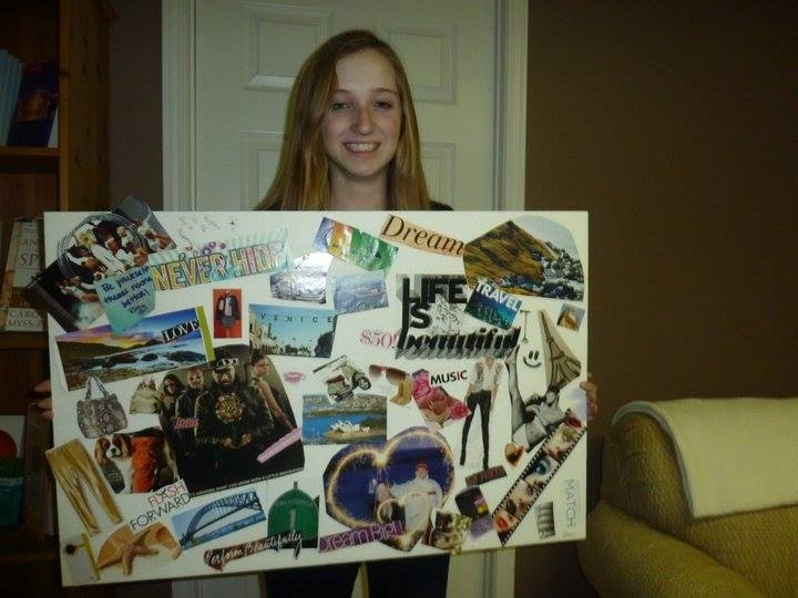 A woman holding her vision board.